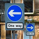 "Two """"give way"""" road signs indicating oppossite directions to travel, Glaasgow, Scotland, UK."