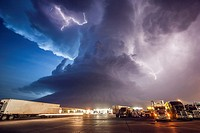Amazing supercell storm during twilight nears a York Nebraska truck stop on I80 as it spits out lightning, June 17, 2009. Only a half hour or so earli...