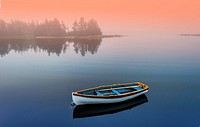 A boat moored at sunrise in a calm sea, Halifax, Canada
