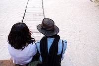 Girl and boy in trip on desert railway. Venice, Veneto. Italy.