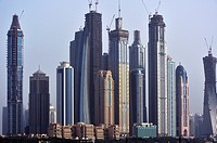 Panorama with skyscrapers, different levels of buildings and ambitious construction works, Dubai, United Arab Emirates.