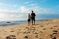 A couple on a beach along the Indian Ocean, the Garden Route, Kwazulu Natal, South Africa