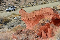 Jeep passing odd formations, Mojave Desert, California, USA.