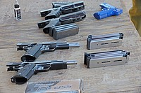 Unloaded pistols on bench, outdoor shooting range, Santa Clarita, California, USA.