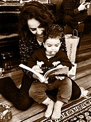 A mother reads to her son.