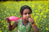 CHildren playing in mustard field in Bangladesh.