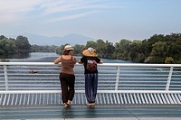 Two woman look out over the water from Sundial Bridge in Redding, California, United States.