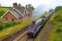 LNER Class A4 60009 Union of South Africa steam train passing Cumwhinton Station Cumbria Settle to Carlisle Railway Line England UK.
