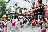 tourists at montmatrre at the corner of rue saint rustique and rue des saules, paris, ile de france, france.