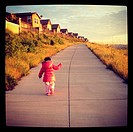 Suburbia - a child on a walk next to a row of houses in San Ramon, California, USA