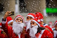 Santas doing a selfie during Santa Claus Race in Madrid, Spain