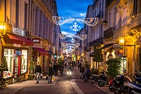 Street in central Montpellier with Christmas Decorations, Saint Guilhem Street, France.