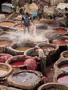 Men working in tannery in Fez, Morocco.