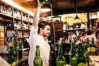 Pouring cider, Restaurant Sidrería Tierra Astur, Gijón, Asturias, Spain.