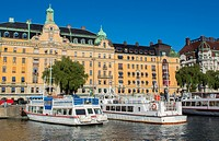Stockholm Sweden beautiful city downtown center skyline from water with boats and buildings from cruise boat.