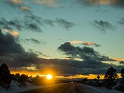 Sunset over New Mexico State Road 68 in December.