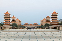Kaohsiung, Taiwan: Sunset at Fo Guang Shan buddist temple of Kaohsiung, Taiwan with many tourists walking by.