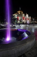 Palacio De Las Bellas Artes-Palace Of Fine Arts at night with a fountain in the foreground, Mexico City, Mexico, Central America.