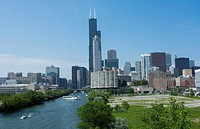 Chicago Illinois skyline from the South Chicago River branch with Sears Tower or Willis Tower in the back with skyscrapers.