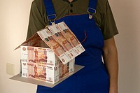 Russian Federation. Builder with a model house of Russian money.