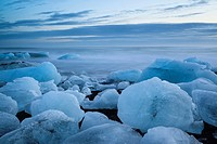 Icebergs from the Jokulsarlon glacial lagoon washed up on a nearby black volcanic sand beach from the North Atlantic Ocean. South Iceland.