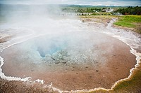 View of hot springs in the Haukadalur valley on the slopes of Laugarfjall hill, Iceland.