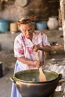 An elderly Oaxacan Zapotec cook prepares traditional food at El Sabor Zapoteco Cooking School in Teotitlan, Mexico.