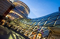 Angled view of the contemporary glass roof at night, Zlote Tarasy Shopping mall, modern architecture, Warsaw, Poland, Europe.