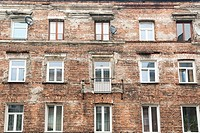 Exterior of an occupied brick apartment building left over from Communist time period when all decorations were removed, symbolizing a move against ca...