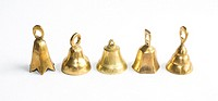 Five brass bells on white background.