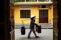 Woman carrying baskets, Hoi An, Vietnam.