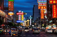 View down Thanon Yaowarat road at night in central Chinatown district of Bangkok Thailand. Yaowarat and Phahurat is Bangkok´s multicultural district, ...