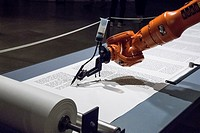 A robot writes a Torah, The Jewish Museum, Berlin, Germany.