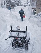 Man about to use his snow-blower, Sherbrooke, Quebec, Canada.