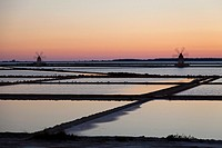 Salt ponds and the picturesque windmills at the Stagnone lagoon, Marsala, Sicily, Italy, Europe.