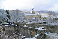 The monastery of Santa María de El Paular seen in Winter from El Perdón bridge over Lozoya river, the last point where convicted people could appeal h...