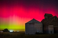 Bright red auroras dance over Iowa during a short but intense outburst of northern lights.