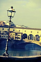 """Street lamp in front of Ponte Vecchio. Photo executed in a range of """"""""cross processing""""""""."""