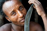 Man belonging to the Kereyu tribe holding his knife ( Ethiopia).