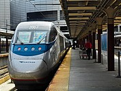 An AMTAK train stands at South Station in Boston, Massachusetts. AMTRAK Acela Express train power car number 2007.