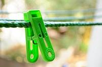 Green Cloth clips on rope ,Poona,Mahareashtra,India.