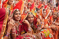 Young woman in their typical colourful traditional dress at the camel and livestock fair Pushkar Fair or Pushkar Mela, Pushkar, Rajasthan, India, Asia...