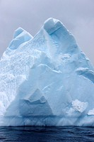 pinnacle pyramid shaped aged iceberg near cuverville island Antarctica.