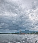 Cumulonimbus clouds over Memphremagog lake, Magog, Quebec, Canada.