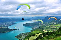 Paragliders above the lake of Annecy, Haute-Savoie, French Alps, France.