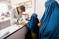 Laboratory staff draws blood of woman wearing burka for blood test in laboratory of Central Hospital of Afghan Red Crescent Society, Kabul, Afghanista...