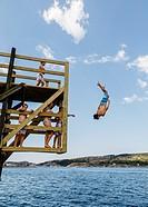 Kid jumps to the sea, Fjallbacka, bohuslan region, west coast, Sweden.