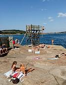 People sunbathing by the sea at Fjallbacka, bohuslan region, west coast, Sweden.