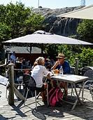 People eating at the Vaderoarnas Vardshus restaurant, Vaderoarna, (The Weather Islands) archipelago, bohuslan region, west coast, Sweden.
