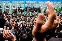 Shia Muslims listening the festive sermon and beating themselves in front of the Mausoleum the Shrine of Ali in the Day of Ashura, tenth day of Muharr...